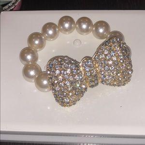 Betsey Johnson embellishes bow bracelet